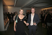 Daisy Garnett and Nicholas, Vogue 90th birthday party and to celebrate the Vogue List, Serpentine Gallery. London. 8 November 2006. ONE TIME USE ONLY - DO NOT ARCHIVE  © Copyright Photograph by Dafydd Jones 66 Stockwell Park Rd. London SW9 0DA Tel 020 7733 0108 www.dafjones.com