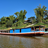 Slow Boat Moored Along Shore in Luang Prabang, Laos<br />