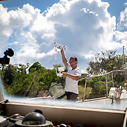 AUGUST 27, 2018--CULEBRA---PUERTO RICO--<br /> Miguel Fontanez with his drone on the deck of the boat he lives in with his wife in Culebra.<br /> (Photo by Angel Valentin/Freelance)