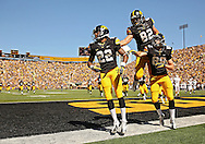 September 21 2013: Iowa Hawkeyes wide receiver Damond Powell (22), Iowa Hawkeyes tight end Ray Hamilton (82), and Iowa Hawkeyes wide receiver Matt Vandeberg (89) celebrate after Powell's 29 yard touchdown reception during the third quarter of the NCAA football game between the Western Michigan Broncos and the Iowa Hawkeyes at Kinnick Stadium in Iowa City, Iowa on September 21, 2013. Iowa defeated Western Michigan 59-3.