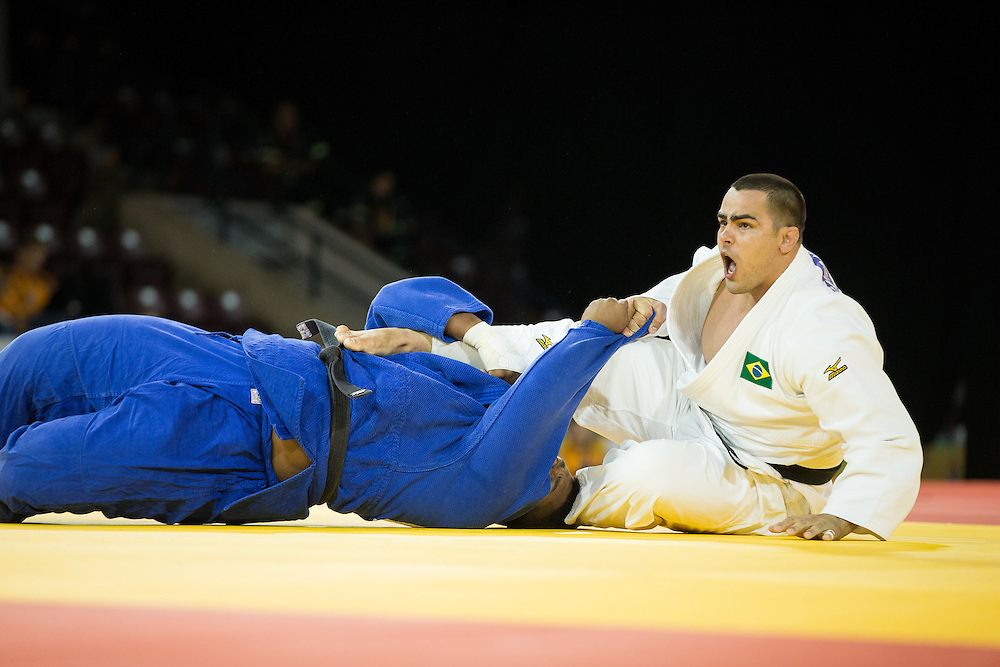 David Moura (R) of Brazil reacts after throwing Freddy Figueroa of Ecuador to win the gold medal in the men's judo +100kg class at the 2015 Pan American Games in Toronto, Canada, July 14,  2015.  AFP PHOTO/GEOFF ROBINS
