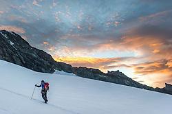 """THEMENBILD - Bergsteiger bei Morgendämmerung am Ködnitzkees. Der Großglockner ist mit 3798 m ü.A. der höchste Berg Österreichs und ein beliebtes Ziel zahlreicher Bergsteiger. Er ist in der Glocknergruppe in den Hohen Tauern. Aufgenommen am 11.10.2014 in Tirol, Österreich // Mountaineer on """"Koednitzkees"""" Glacier at dawn. Grossglockner is the highest mountain of austria and is located in the Hohe Tauern mountain range which is part of the central eastern alps. Tyrol, Austria on 2014/10/11. EXPA Pictures © 2014, PhotoCredit: EXPA/ Michael Gruber<br /> <br /> ***** ACHTUNG BILD WURDE MIT DIGITALEN FILTERTECHNIKEN VERAENDERT / NOTE, THE PICTURE HAS CHANGED WITH DIGITAL FILTERING *****"""