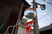 old Buddhist temple reflecting in a modern traffic safety mirror Nara Japan