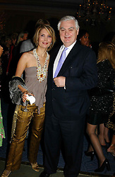 """MISS SARI AKHAVAN and LORD LAMONT at a party to celebrate the publication of Bruce Oldfield's autobiography """"Rootless"""" held in aid of Crimestoppers at Claridge's, Brook Street, London W1 on 22nd September 2004.<br /><br />NON EXCLUSIVE - WORLD RIGHTS"""