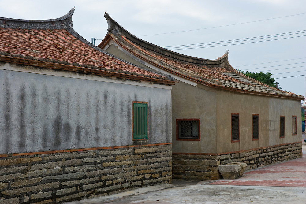 Traditoinal Fujian style architecture on Kinmen, Republic of China ROC (Taiwan). ..Kinmen (Jinmen) formely known as Quemoy. The island lies less than 2km off the coast of China, and in 1949 was turned into a front-line of defense for Taiwan by Chiang Kai-shek and the Chinese nationalist Kuomintang (KMT) in the ongoing war with the communist PRC. The island existed under martial law until 1993. Today, Kinmen is a popular tourist destination and home to a lot of traditional Fujian-style architecture.
