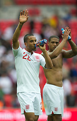 LONDON, ENGLAND - Saturday, June 2, 2012: England's Theo Walcott applauds the supporters after the 1-0 victory over Belgium during the International Friendly match at Wembley. (Pic by David Rawcliffe/Propaganda)