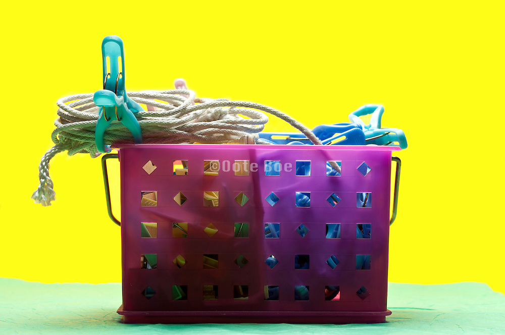 purple basket object with rope and other content on yellow green background