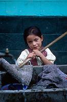 Schoolgirl doing chores at her school, Santa Clara, Guatemala