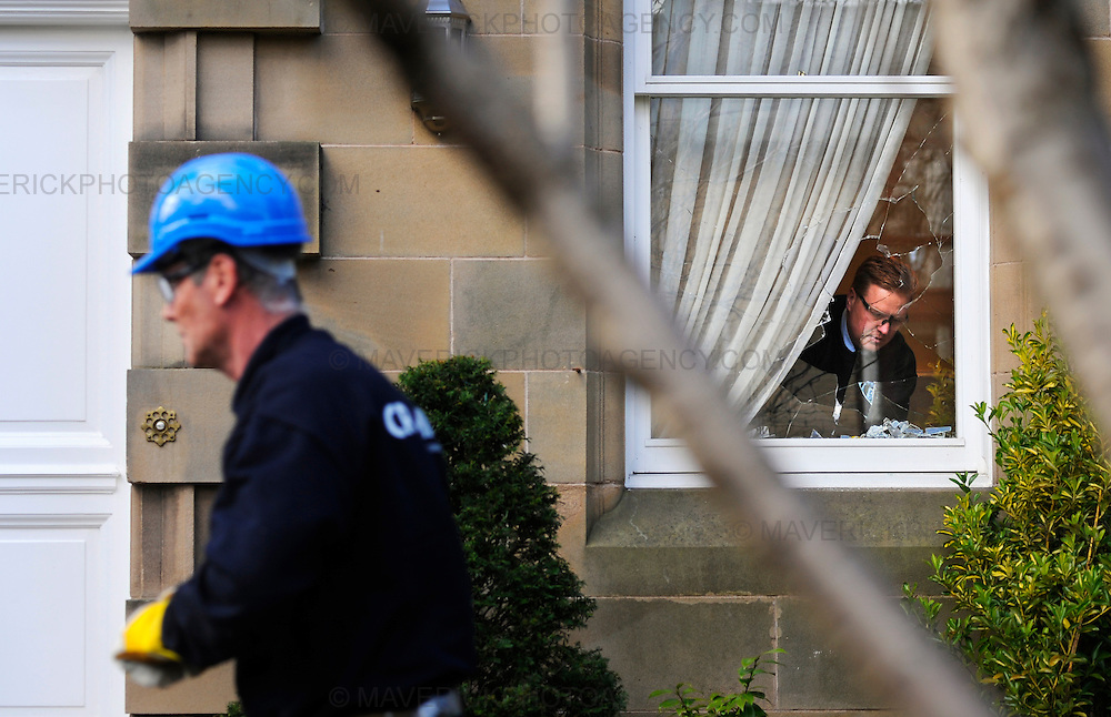 "The Edinburgh home of former Royal Bank of Scotland boss Sir Fred Goodwin has been attacked by vandals.  Windows were smashed and a Mercedes S600 car parked in the driveway was vandalised.  Police said they were investigating these claims as part of their inquiry, adding that they took planned attacks ""very seriously"". Pictured CR Smith glaziers repair the windows."