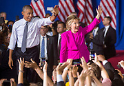 President Barack Obama and Democratic presidential candidate Hillary Clinton walk together on stage during a campaign event in Charlotte.