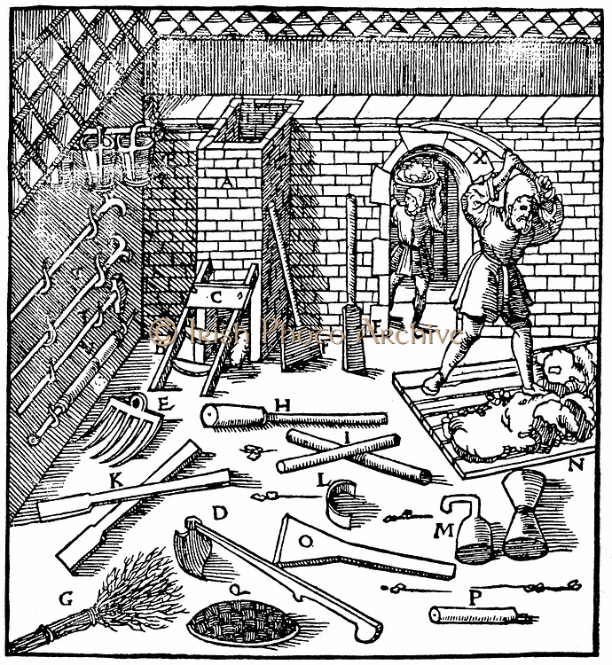 Smelting of ores (gold, silver, copper and lead). Workman beats clay to make lute to line furnace. On floor are various tools needed during process. From Agricola 'De re metallica', Basel 1556