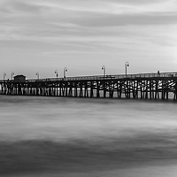 San Clemente pier sunset black and white panorama with the sun setting behind Lifeguard Tower Zero. Panoramic photo ratio is 1:3. Copyright ⓒ 2017 Paul Velgos with All Rights Reserved.