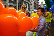 Volunteers tring baloons for the Pride Arch prior to the Pride March in New York City.