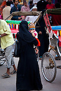 Muslim woman and child out shopping in city of Varanasi, Benares, Northern India