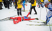 Caitlin Gregg collapses after crossing the finish line winning the of the 40th American Birkebeiner cross country ski race.