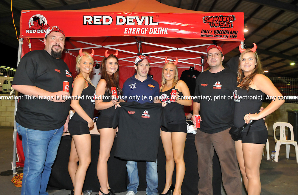 Chris Atkinson with Red Devil Energy Drink staff.Offical Start.Red Devil Energy Drink Rally of Queensland.Nambour Show Grounds, Nambour, Sunshine Coast, QLD.8th of May 2009.(C) Joel Strickland Photographics.Use information: This image is intended for Editorial use only (e.g. news or commentary, print or electronic). Any commercial or promotional use requires additional clearance.