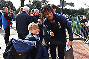 Nathan Ake (5) of AFC Bournemouth signs has a photo with a disabled fan as he arrives at the Vitality Stadium before the Premier League match between Bournemouth and Manchester City at the Vitality Stadium, Bournemouth, England on 2 March 2019.