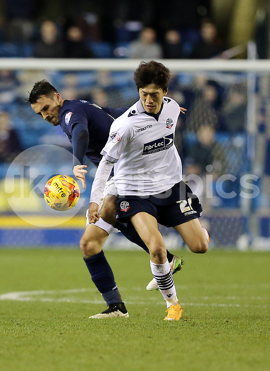 Bolton's Lee Chung-Yong comes away with the ball during the Sky Bet Championship match between Millwall and Bolton Wanderers at The Den, London, England on 19 December 2014. Photo by Dave Peters.