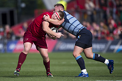 September 30, 2017 - Limerick, Ireland - John Ryan of Munster tackled by Matthew Rees of Cardiff during the Guinness PRO14 Conference A Round 5 match between Munster Rugby and Cardiff Blues at Thomond Park in Limerick, Ireland on September 30, 2017  (Credit Image: © Andrew Surma/NurPhoto via ZUMA Press)