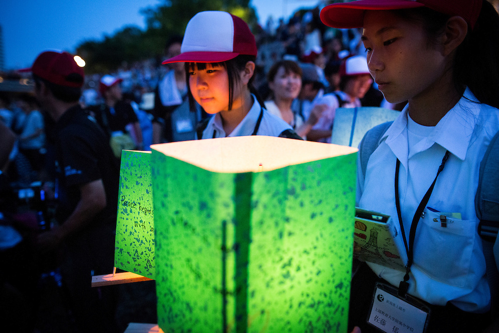 HIROSHIMA, JAPAN - AUGUST 6 : A student wait to float candle lit lanterns with message on the Motoyasu River during the 71st anniversary activities, commemorating the atomic bombing of Hiroshima at the Hiroshima Peace Memorial Park on August 6, 2016 in Hiroshima, western Japan. Japan marks the 71st anniversary of the first atomic bomb that was dropped by the United States on Hiroshima on August 6, 1945 during World War II.  (Photo by Richard Atrero de Guzman/NURPhoto)