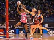 Carla Borrego with the ball for the Thunderbirds with Fellowes for the Tactixin defence during the ANZ Championship Netball game between the Mainland Tactix v Adelaide Thunderbirds at Horncastle Arena in Christchurch. 20th April 2015 Photo: Joseph Johnson/www.photosport.co.nz