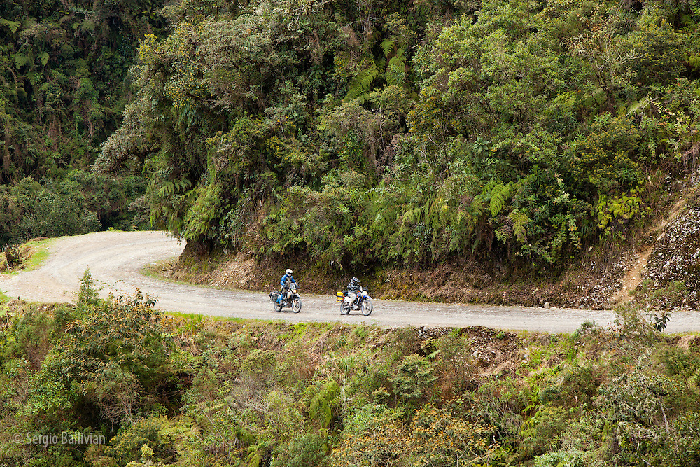 Motorcycle touring The Road of Death, on the eastern side of the Bolivian Andes called the Yungas on the way to Coroico.  This 88 kilometer long road was cut by prisoners of the Chaco war  in the 1030's and used to be the main road linking the Andes to the Amazon basin in Bolivia.  It has now been supplanted by a modern two-lane paved road across the spine of the Andes on the other side of the deep valleys.