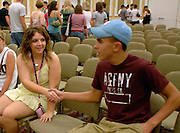 Ohio University freshmen Abbey Hackenberg and Ryan Lang greet each other at the Learning Communities meeting in the Baker Hall Ballroom Sunday evening.