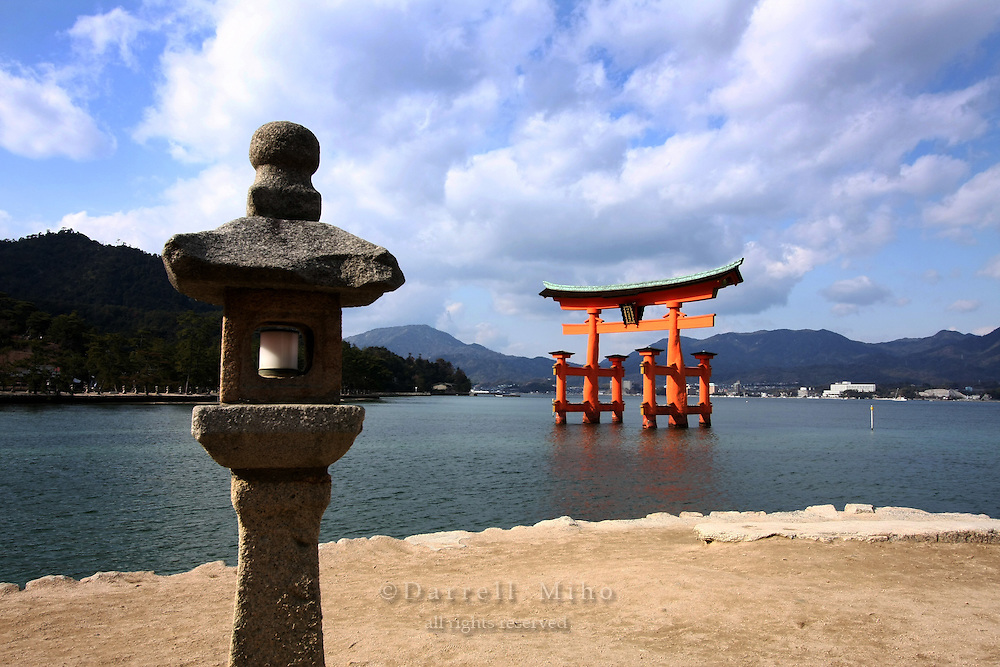 Jan. 24, 2009; Miyajima, Japan - Tori gate and Japanese stone lantern...Miyajima is one of Japan's three most beautiful sights to see.