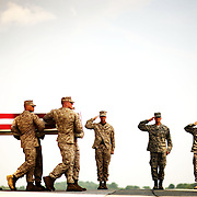The remains of U.S. Marine Corps Corporal Nicholas G. Xiarhos, of Yarmouth Port, Mass., are carried during a Dignified Transfer ceremony on Saturday, July 25, 2009 at Dover AFB in Dover, Delaware.  Xiarhos was killed July 23, 2009 in the Helmand province of Afghanistan during combat operations supporting Operation Enduring Freedom.