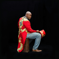 Portrait of Ringmaster Johnathan Lee Iverson, who was born and raised in New York City. Iverson was Ringling Brother's first African American ringmaster. &quot;As the ringmaster of Ringling Brothers, you're the ambassador of the great American circus tradition. When you're speaking for Ringling Brothers, you're really speaking for the entire industry. What I love most [is that] it is possible to have extraordinary entertainment, high art, and appeal to anyone. Everybody loves the circus. [It's] a buffet of the extraordinary.&quot;<br />
