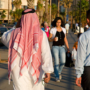 BEIRUT,LEBANON- MAY 2009 : A Saudi male tourist, wearing a traditional  dishdasha  strolling along the Corniche . 05/30/2009 .The Corniche is a walk  that borders on the city next to the sea where many Lebanese  and tourist are going to walk and to relax . Beirut, Lebanon.   ( Photo by Jordi Cami )