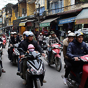 A bustling street scene in Hanoi as scooters navigate the old quarter of Hanoi. Hanoi is the capital of Vietnam and the country's second largest city. Hanoi, Vietnam. 17th March 2012. Photo Tim Clayton