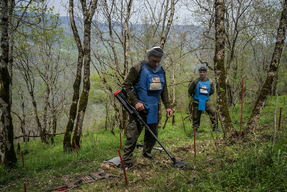 HAGOB KAMARI, NAGORNO-KARABAKH - APRIL 20: Samvel Karapetyan (L), a sapper with the charity HALO Trust, works to clear a minefield as Rudik Sargsyan, commander of mine clearance team six, watches on April 20, 2015 in Hagob Kamari, Nagorno-Karabakh. Since signing a ceasefire in a war with Azerbaijan in 1994, Nagorno-Karabakh, officially part of Azerbaijan, has functioned as a self-declared independent republic and de facto part of Armenia, with hostilities along the line of contact between Nagorno-Karabakh and Azerbaijan occasionally flaring up and causing casualties. (Photo by Brendan Hoffman/Getty Images) *** Local Caption *** Samvel Karapetyan; Rudik Sargsyan