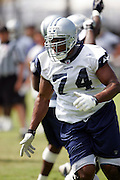Rookie tackle Darrick Sanders and the Dallas Cowboys work out at their summer training camp in Oxnard, CA on 08/03/2004. ©Paul Anthony Spinelli