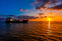 Trawler (fishing ship) at sunset off Key West, Florida Keys, Florida USA