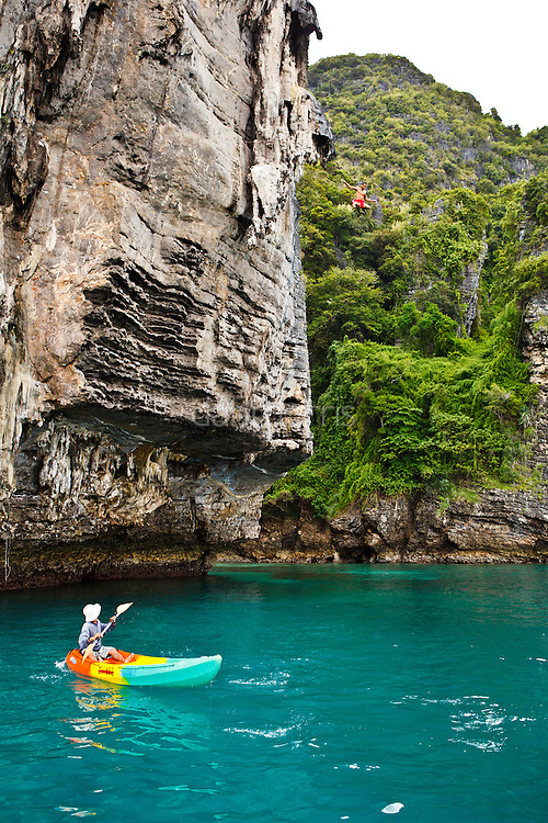 "Climber ""deep water soloing"" without rope, returning to the sea... Poda Island, Krabi, Thailand"