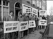 "Farmers Protest in Kildare Street,Dublin..1985..01.02.1985..02.01.1985..1st February 1985..Photograph of Farmers protesting outside the offices of the legal firm of Whitney,Moore and Keller where tenders for the ""Clover"" assets were being submitted..In Nov 1984 Clover Meats closed with a loss of 600 jobs. Farmers who had supplied cattle to the factory were not paid for deliveries. As the assets were to be sold off, farmers demanded that they be paid the outstanding £2,000,000..Mr Michael Slattery,Munster Vice-President IFA,Mr Laurence Carroll,Chairman,Clover Farmers Creditors and Mr Tom Kearny,Executive Member,ICMSA led the protest."