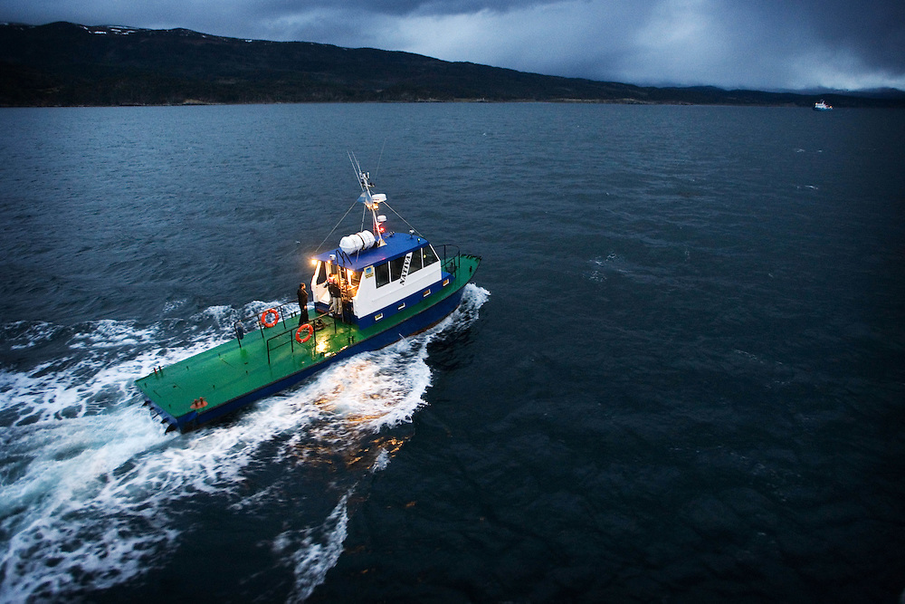 A pilot boat heads off into the darkness near Drakes Passage, southern Argentina.