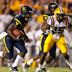 Sep 25, 2010; Baton Rouge, LA, USA; West Virginia Mountaineers wide receiver Jock Sanders (9) runs past LSU Tigers safety Brandon Taylor (15) for a touchdown during the second half at Tiger Stadium. LSU defeated West Virginia 20-14.  Mandatory Credit: Derick E. Hingle