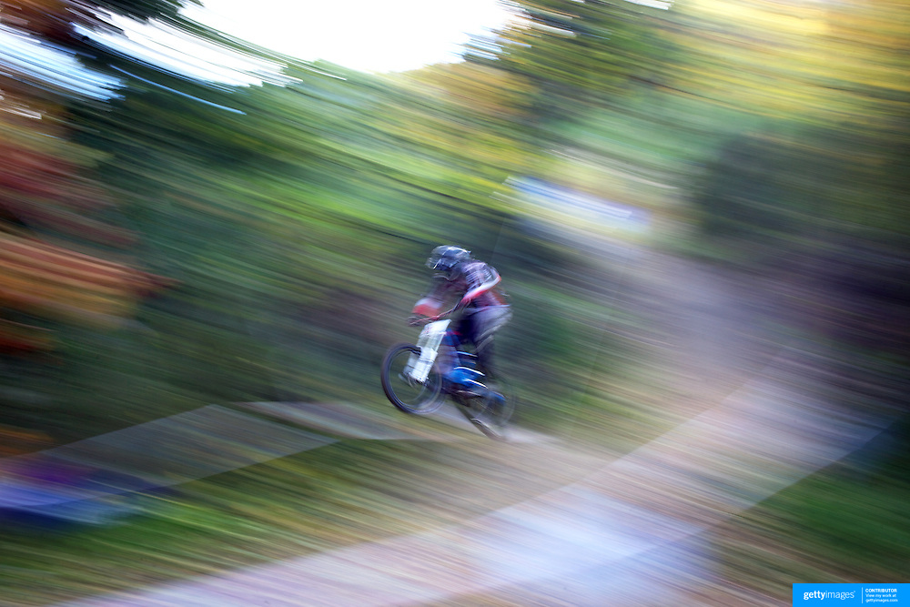 Mountain bike racers tackle the Ben Lomond Forest course high above Queenstown during practice for the Corona Dirtmasters Downhill event in Queenstown, Central Otago, which takes place on Sunday. The technically demanding course will start at the Gondola and finish in Brecon Street. The event was part of the inaugural Queenstown Bike Festival, taking place from 16th-25th April. The event hopes to highlight Queenstown's growing profile as one of the three leading biking centres in the world. Queenstown, Central Otago, New Zealand. 23nd April 2011. Photo Tim Clayton..
