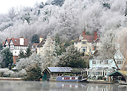 © Licensed to London News Pictures. 12/12/2012. Henley, UK Houses nestle amongst frosty trees on the River Thames. Frosty weather around Henley today 12 December 2012. Fog and ice has caused disruption around the country.  Photo credit : Stephen Simpson/LNP