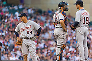 Miguel Cabrera #24 of the Detroit Tigers plays around during a pitching change with Alex Avila #13 and Anibal Sanchez #19 on the mound during a game against the Minnesota Twins on June 15, 2013 at Target Field in Minneapolis, Minnesota.  The Twins defeated the Tigers 6 to 3.  Photo: Ben Krause