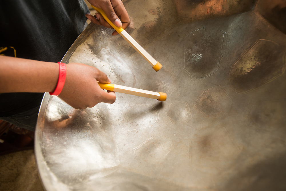 Close-up of man's hands playing a steel drum in Baltimore, Maryland