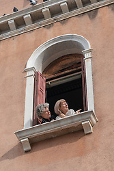 Two women at a window in Venice. From a series of travel photos in Italy. Photo date: Monday, February 11, 2019. Photo credit should read: Richard Gray/EMPICS