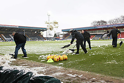 Volunteers & ground staff clear snow from the pitch before kick off f- Photo mandatory by-line: Matt McNulty/JMP - Mobile: 07966 386802 - 17.01.2015 - SPORT - Football - Rochdale - Spotland Stadium - Rochdale v Crawley Town - Sky Bet League One