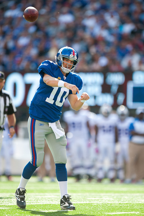 EAST RUTHERFORD, NJ - OCTOBER 16: Eli Manning #10 of the New York Giants passes during the game against the Buffalo Bills at MetLife Stadium on October 16, 2011 in East Rutherford, New Jersey. The Giants defeated the Bills 27 to 24. (Photo by Rob Tringali) *** Local Caption *** Eli Manning