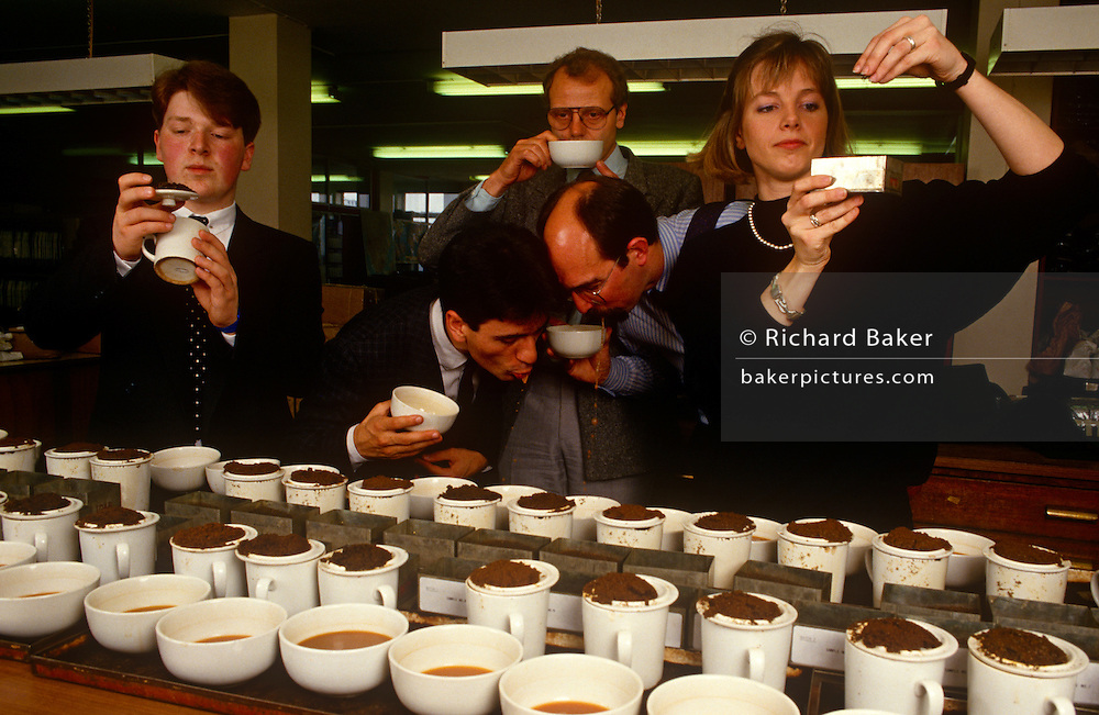 A team of English tea-tasters employed by the tea company Lyons sample different blends for the PG Tips brand in the City of London, England UK. With variously-sourced teas from tea estate plantations, they smell, touch, sip, slurp then spit the hot drink out into a spittoon rather than swallow it many times repeatedly. Britons drink 35 million cups of PG Tips a day and world tea production is approximately 3.2 million tonnes a year. Kenya is the largest producer with Sri Lanka a close second. PG Tips is imported as single estate teas from around the world and blended in precise proportions set by the tea tasters to make blend 777, which can contain between 12 and 35 single estate teas at any one time depending on season..