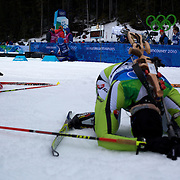 Winter Olympics, Vancouver, 2010.Competitors feel the pain after finishing during the Women's 7.5 KM Sprint Biathlon at The Whistler Olympic Park, Whistler, during the Vancouver  Winter Olympics. 13th February 2010. Photo Tim Clayton