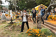 Musicians lead a procession to the gravesite of a family member during the Day of the Dead festival October 31, 2017 in Tzintzuntzan, Michoacan, Mexico.
