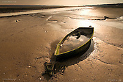 A tiny boat has floated here at the Malltraeth Estuary, Anglesey, for years, but one winter it submerged under choppy waves, and it's never refloated.